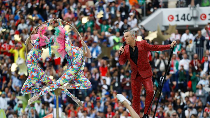 Robbie Williams performs during the opening ceremony