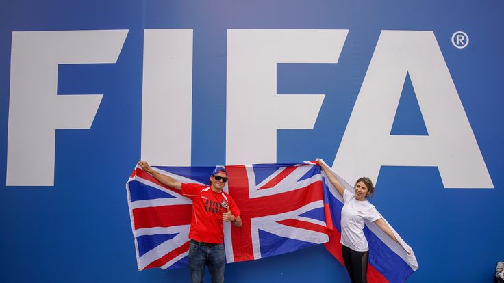 England fan Richard Pearce, who runs a football academy in Russia, poses with a Russian fan