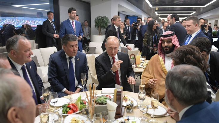 Russian President Vladimir Putin, Saudi Crown Prince Mohammed bin Salman and other guests at the half-time during the Russia 2018 World Cup Group A football match between Russia and Saudi Arabia