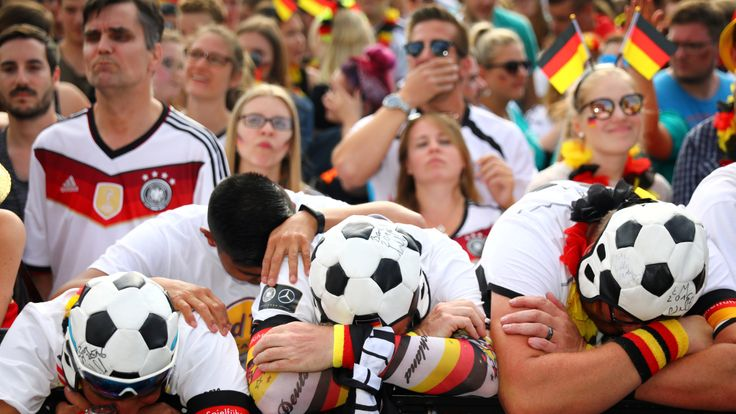 Germany fans react as they watch the match at a public viewing area at Brandenburg Gate