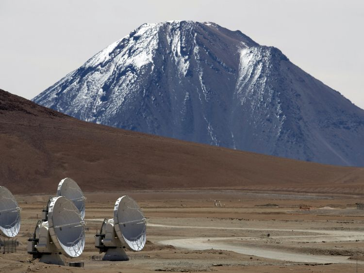 Radio telescope antennas of the ALMA (Atacama Large Millimeter/submillimeter Array) project, in the Chajnantor plateau, Atacama desert, some 1500 km north of Santiago, on March 12,2013. The ALMA, an international partnership project of Europe, North America and East Asia with the cooperation of Chile, is presently the largest astronomical project in the world. On Wednesday March 13 will be opened 59 high precision antennas, located at 5000 of altitude in the extremely arid Atacama desert. AFP PH