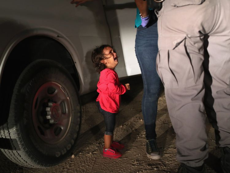 A two-year-old Honduran asylum seeker cries as her mother is detained near the US-Mexico border