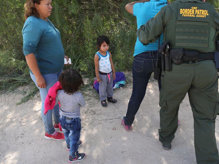 Border Patrol agents take Central American asylum seekers into custody near McAllen Texas