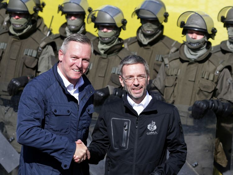 Defence Minister Mario Kunasek (L) and Interior Minister Herbert Kickl in front of soldiers during the exercise