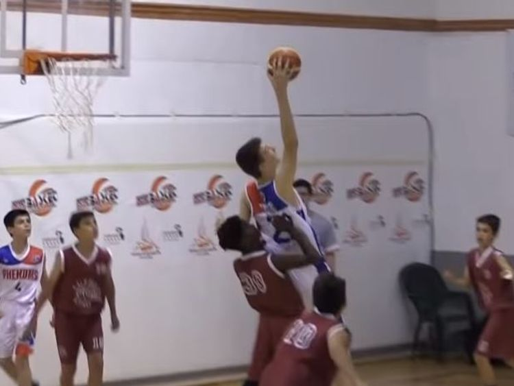 A 6ft 10 12-year-old boy has become a global sensation after video emerged of him towering above his opponents and dominating an entire basketball match.  pic:  BasketCantera.TV