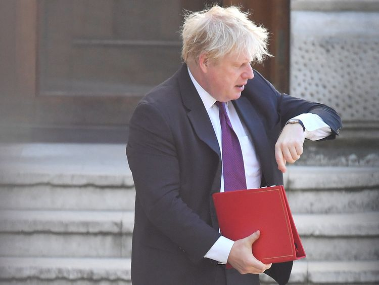 Boris Johnson walks to Downing Street