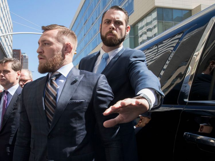 Mixed martial arts fighter Conor McGregor leaves a Brooklyn Supreme court, Thursday, June 14