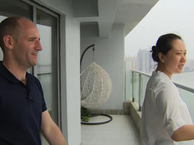 Zhang Tong, an estate agent working at Moon Island, with Tom Cheshire
