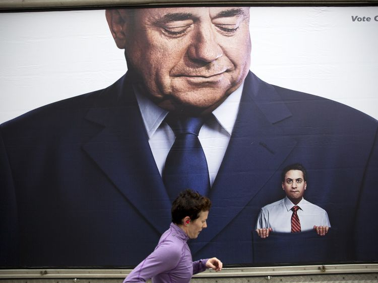A lorry displaying a Conservative party poster which pictures Labour Party Leader Ed Miliband in the pocket of former Scottish First Minister Alex Salmond parked outside the Labour Party's Spring event in Birmingham, central England on March 14, 2015.