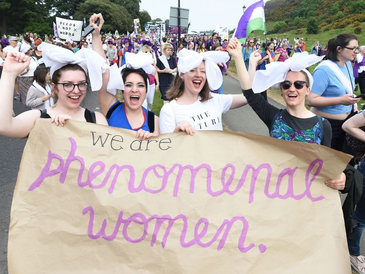 A group of women with their homemade banner in Edinburgh