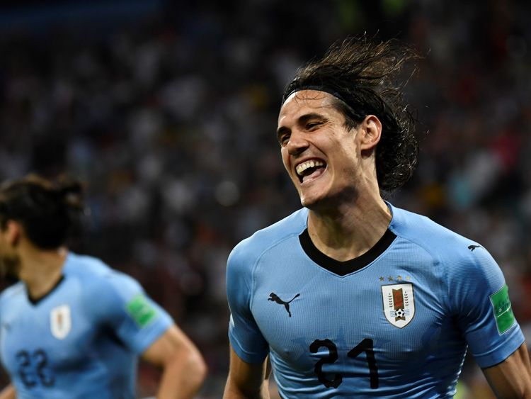 Edinson Cavani celebrates putting Uruguay in front against Portugal
