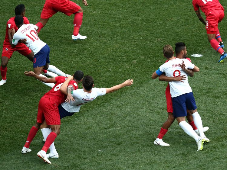England players find themselves held up by Panamanian defenders during a corner
