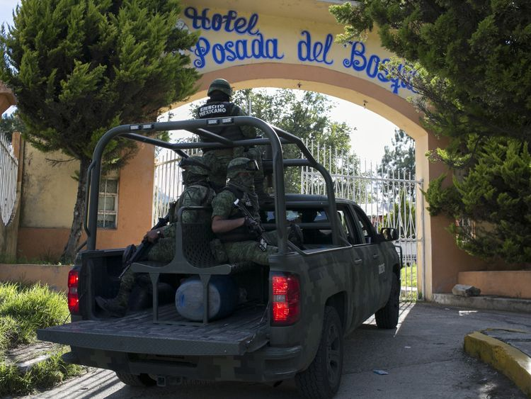 Mexican towns police force arrested over political murder