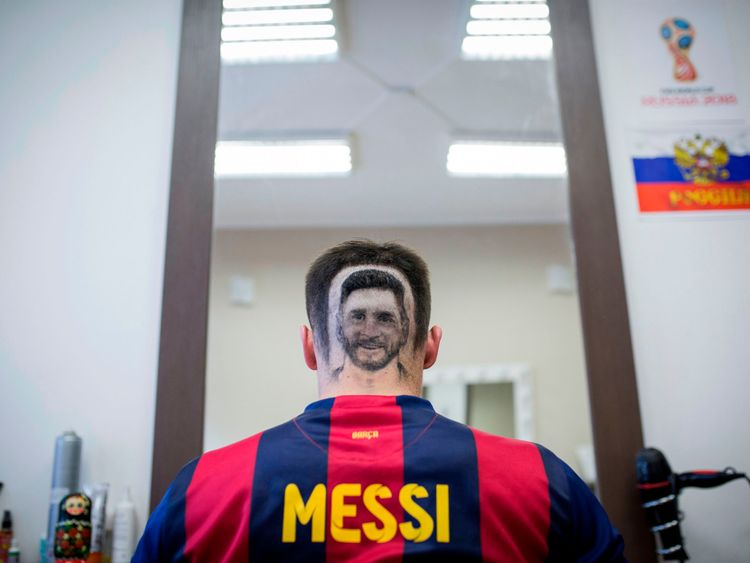 A football fan sports a hair tattoo showing the portrait of Argentinian football player Lionel Messi