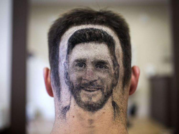 messi hair barber shaves player s image into fans hair for world cup