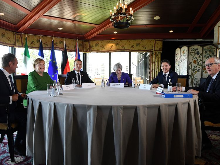 European Council president Donald Tusk, German Chancellor Angela Merkel, French President Emmanuel Macron, British Prime Minister Theresa May, Italian Prime Minister Giuseppe Conte and President of the European Commission Jean-Claude Juncker on day one of the G7 meeting