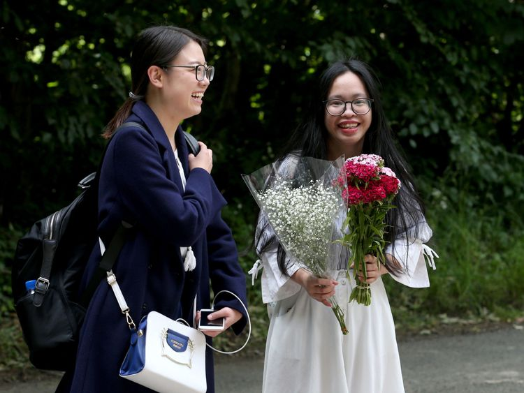 Fans Yunyao Li, 23 (left) and Qiong dan Xu, 24, wait at the entrance to the castle