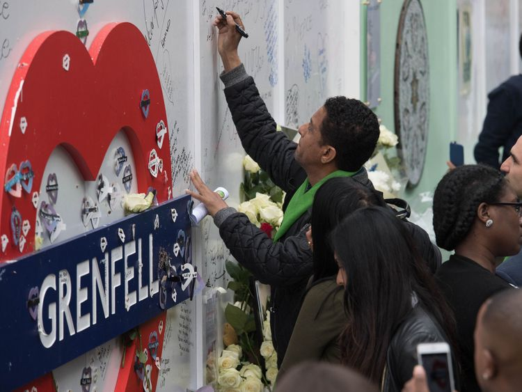 A man holds a heart shaped tribute outside St Helen's Church, North Kensington, following a Grenfell Tower fire Memorial Service to mark one year since the blaze, which claimed 72 lives. PRESS ASSOCIATION Photo. Picture date: Thursday June 14, 2018. Thursday marks 12 months since a small kitchen fire in the high-rise turned into the most deadly domestic blaze since the Second World War. See PA story MEMORIAL Grenfell. Photo credit should read: David Mirzoeff/PA Wire