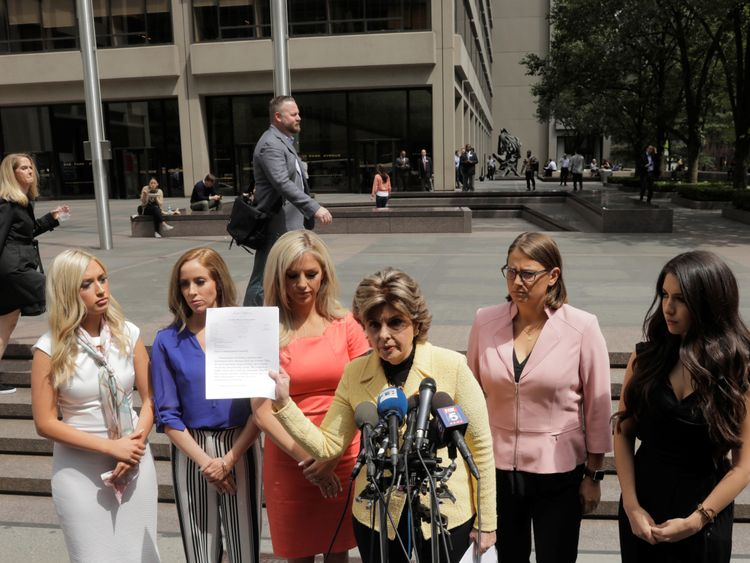 Attorney Gloria Allred holds the letter sent to the NFL on behalf of several former Houston Texans cheerleaders