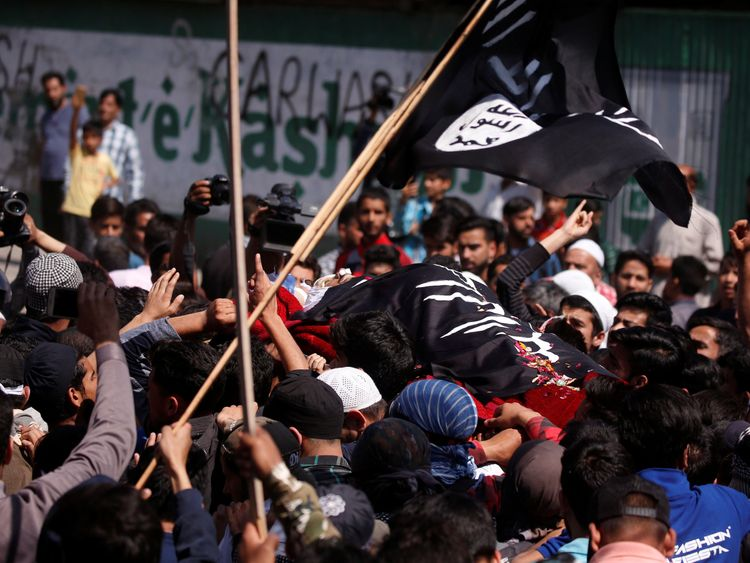 People carry the body of Kaisar Ahmad Bhat during the funeral