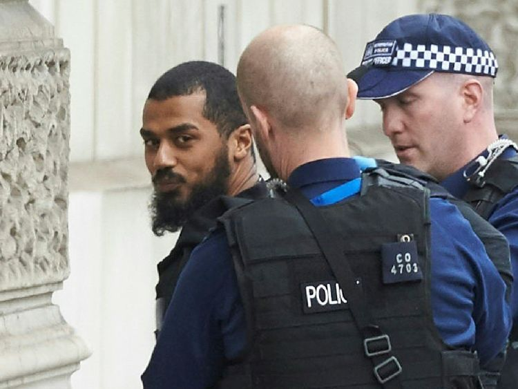 Firearms officiers from the British police detain a man, later named as Khalid Mohammed Omar Ali, on Whitehall near the Houses of Parliament in central London on April 27, 2017 before being taken away by police. Metropolitan police attended an incident on Whitehall in central London near the Houses of Parliament where one man was arrested, police said. Khalid Mohammed Omar Ali, a 27-year-old from north London, is accused of preparing terrorist acts after being arrested not far from Prime Ministe