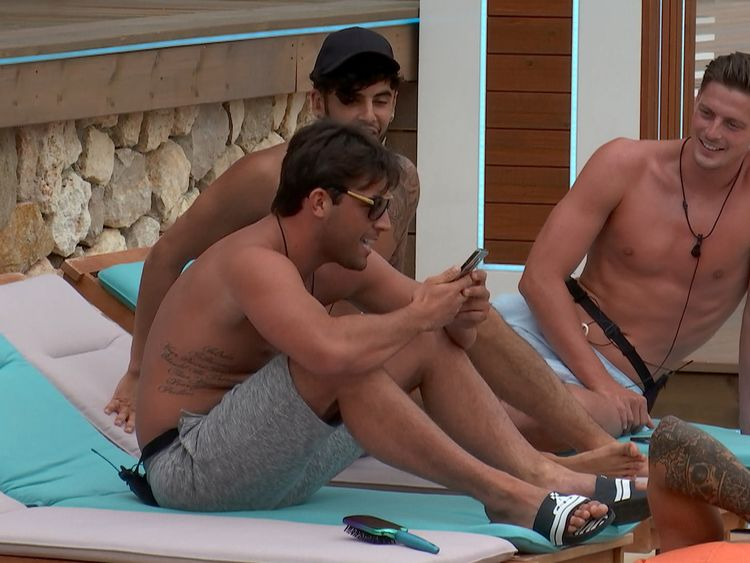 The boys get a text while chilling in the sun