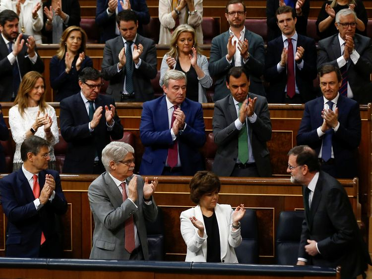 Members of his party clapped as he entered parliament before the vote