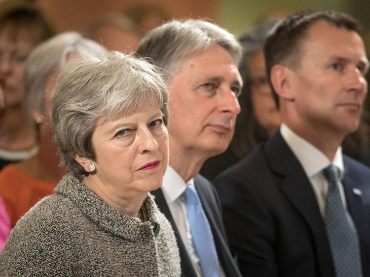 Theresa May said details about the tax rises would be revealed in the autumn