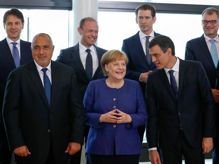 Merkel secures asylum seeker return deals with 14 EU countries