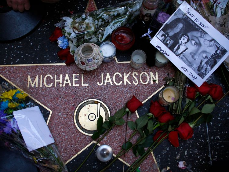 Fans pay tribute to Michael Jacson by laying flowers on his star