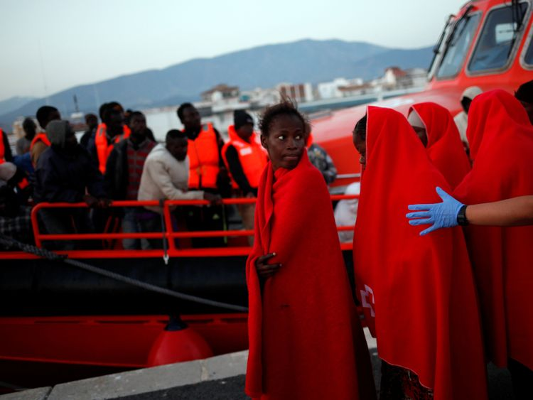 Migrants arriving on a rescue boat at the Spanish port of Motril on Friday