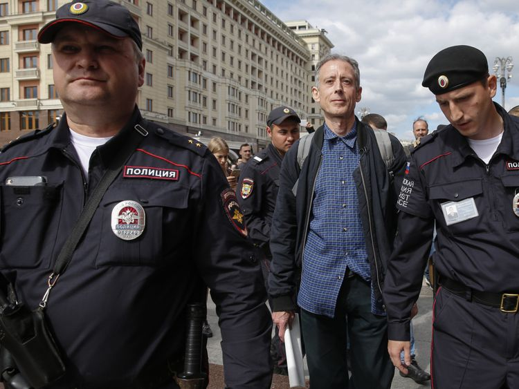Russian police officers arrest British gay rights activist Peter Tatchell following his anti-Putin protest in Moscow on June 14, 2018. (Photo by Maxim ZMEYEV / AFP) (Photo credit should read MAXIM ZMEYEV/AFP/Getty Images)