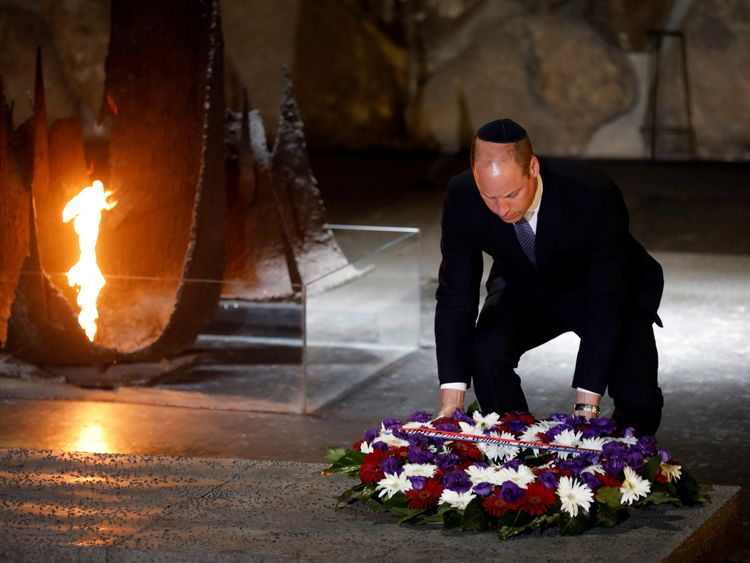 William lays a wreath during a ceremony commemorating the six million Jews killed by the Nazis