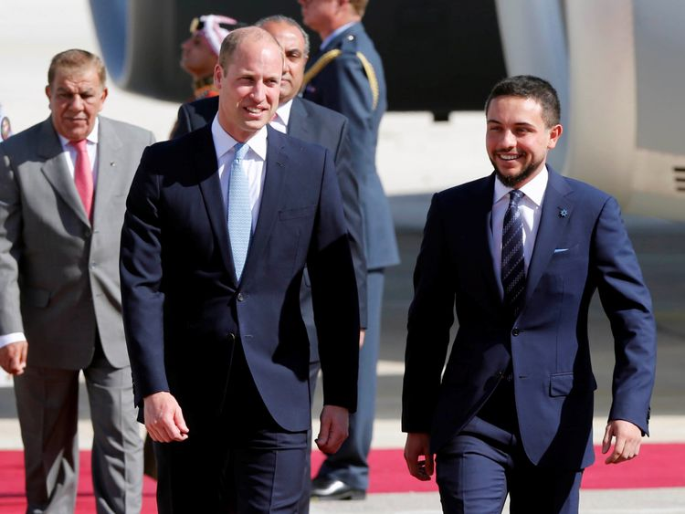 Prince William is welcomed by Jordan's Crown Prince Hussein bin Abdullah II