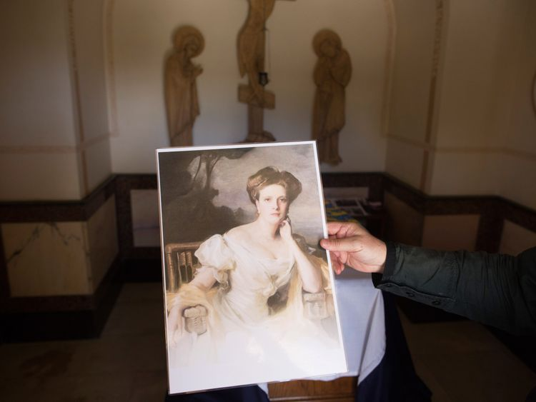 A portrait of Princess Alice of Battenberg next to her tomb