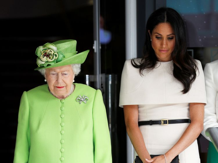 The Queen and Meghan observe a minute's silence for Grenfell