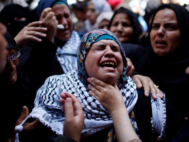 A relative mourns during the Razan's funeral