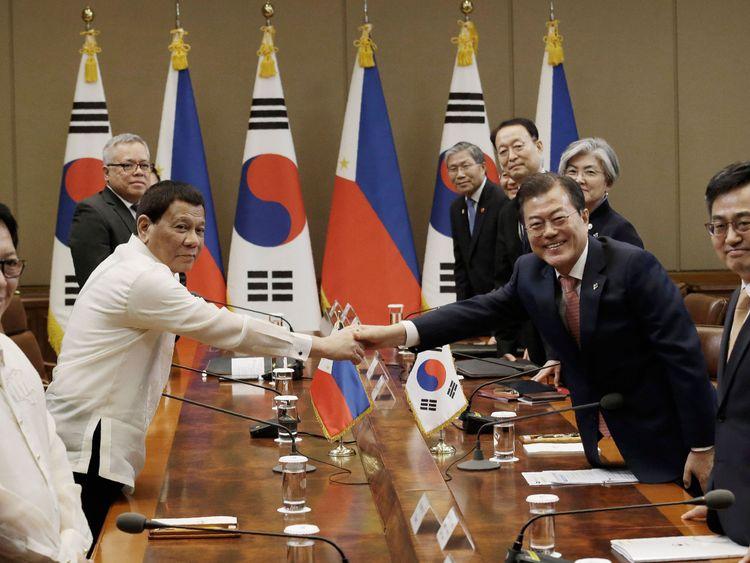 Mr Duterte shakes hands with South Korean president Moon Jae In