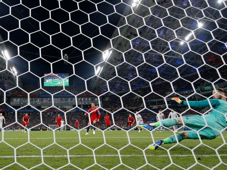 Cristiano Ronaldo scores a penalty past David De Gea