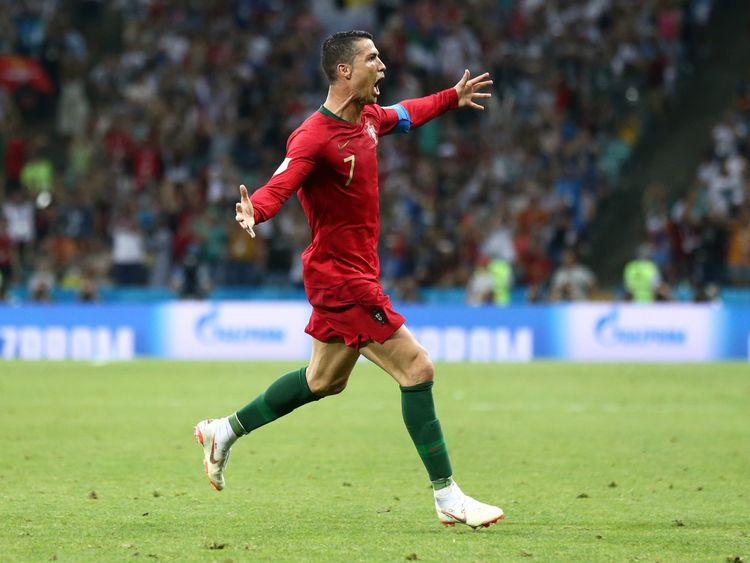Cristiano Ronaldo celebrates after scoring his team's third goal
