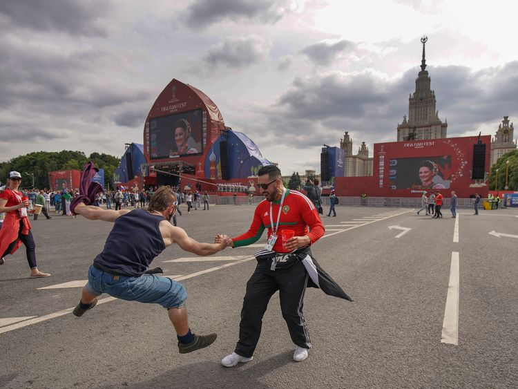 A Russian fan teaches a Moroccan fan to Cossack dance