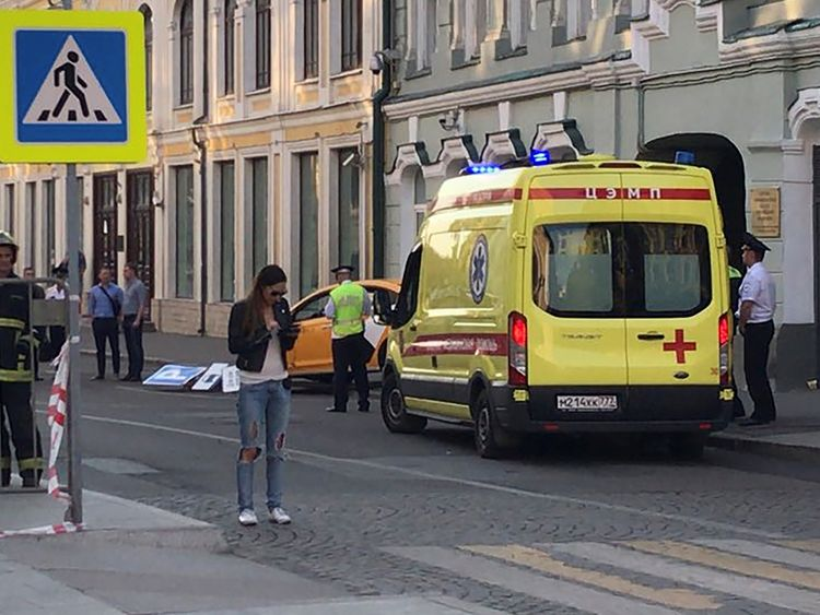 An ambulance next to the damaged taxi in Moscow