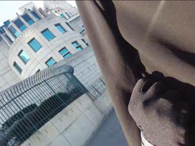 Safaa Boular took a selfie with a clenched fist at the MI6 building