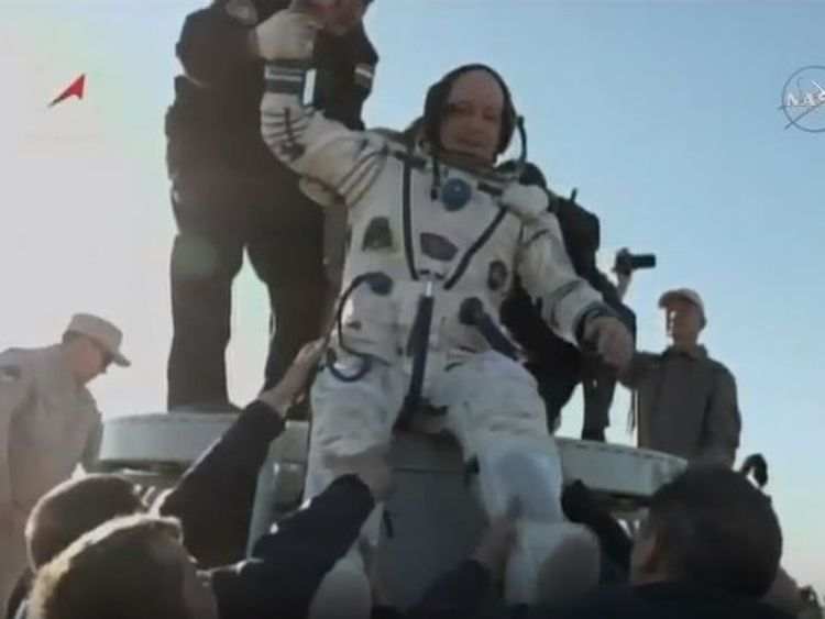 Scott Tingle is brought out of the Soyuz capsule after it touches down in Kazakhstan