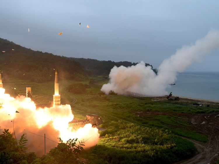 US Army Tactical Missile System (ATACMS) and South Korea's missile system firing Hyunmu-2 firing a missile into the East Sea during a South Korea-U.S. joint missile drill