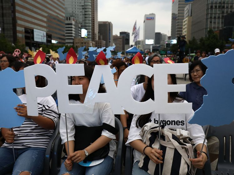 South Korean activists participate in a rally to support of the U.S. and North Korea summit on June 9, 2018