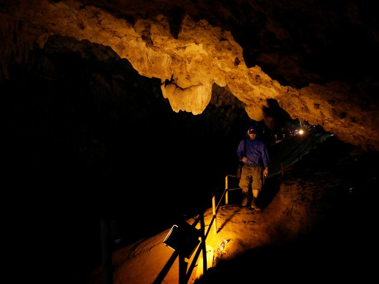 A rescue worker walks in Tham Luang caves