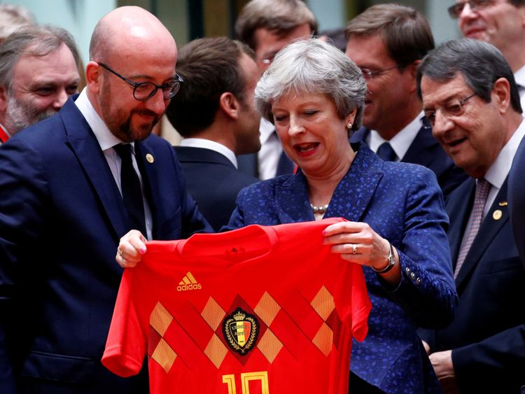 Britain's Prime Minister Theresa May receives Belgium's national soccer team jersey from Belgian Prime Minister Charles Michel as they attend an European Union leaders summit in Brussels, Belgium, June 28, 2018. REUTERS/Francois Lenoir