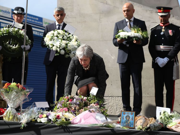 Theresa May lays a floral tribute at the Southwark Needle