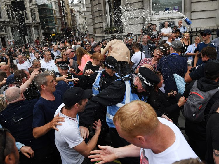 LONDON, ENGLAND - JUNE 09:  Beer is thrown as demonstrators clash with police during a 'Free Tommy Robinson' protest on Whitehall on June 9, 2018 in London, England. Protesters are calling for the release of English Defense League (EDL) leader Tommy Robinson who is serving 13 months in prison for contempt of court.  (Photo by Chris Ratcliffe/Getty Images)